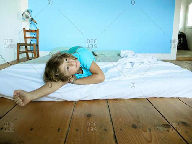Girl on a mattress on floor