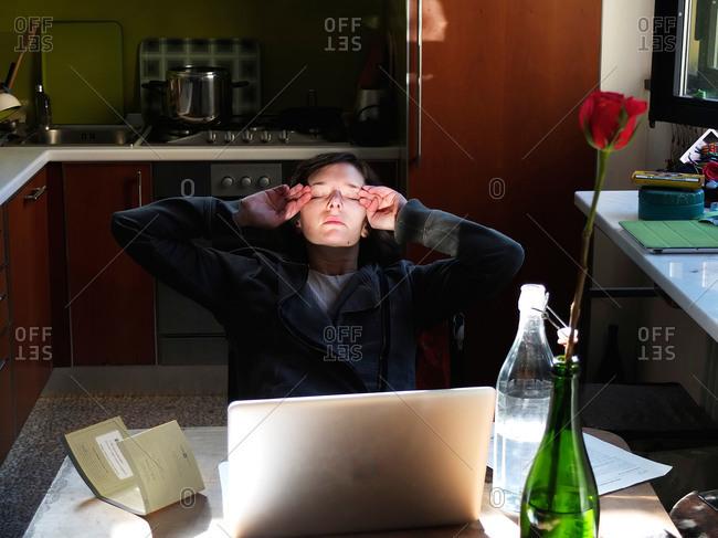 Woman taking break from laptop