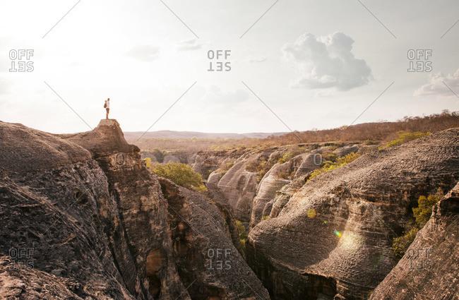 Man standing at mountain overlook, Serra da Capivara National Park, Brazil