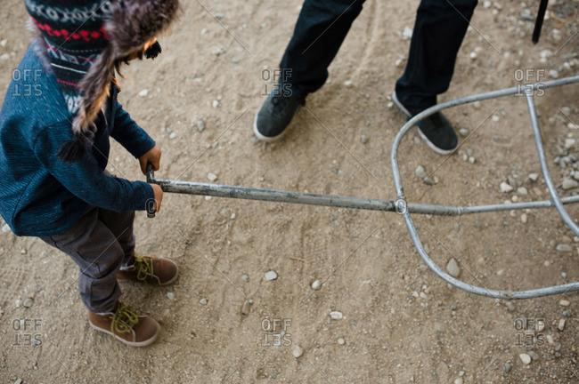 Kid holding dolly at tree farm