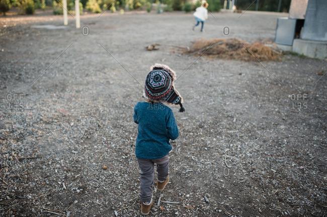 Child wandering tree plantation