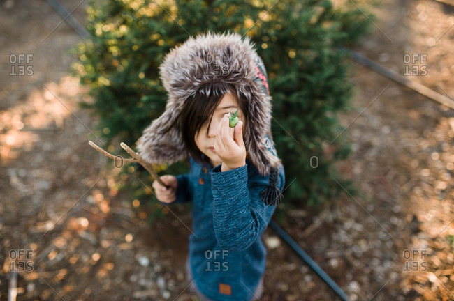 Child holding vegetable at tree farm