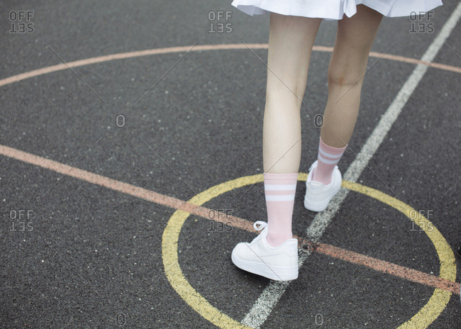 Legs of a girl on a playground