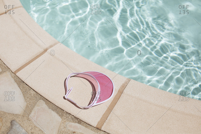 Sun visor by the edge of a swimming pool