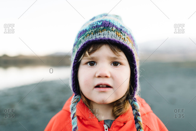 Portrait of a young girl wearing a winter hat