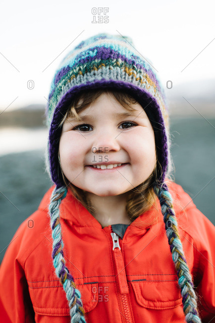 Happy young girl wearing a winter hat