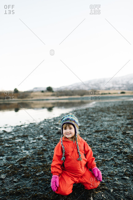 Young girl on the beach in winter