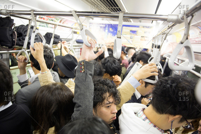 Tokyo, Japan - November 23, 2015: Crowded train in Tokyo, Japan
