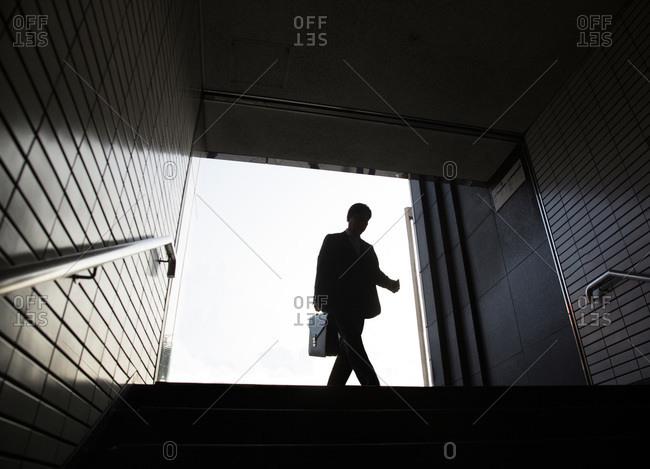 Tokyo, Japan - November 23, 2015: Men entering subway, Tokyo