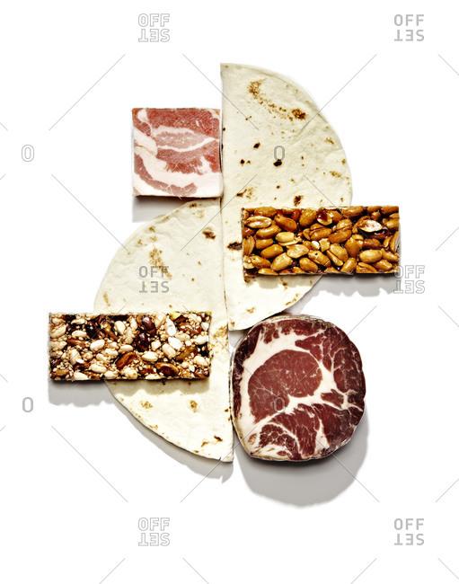Meat, tortilla halves, and granola bars