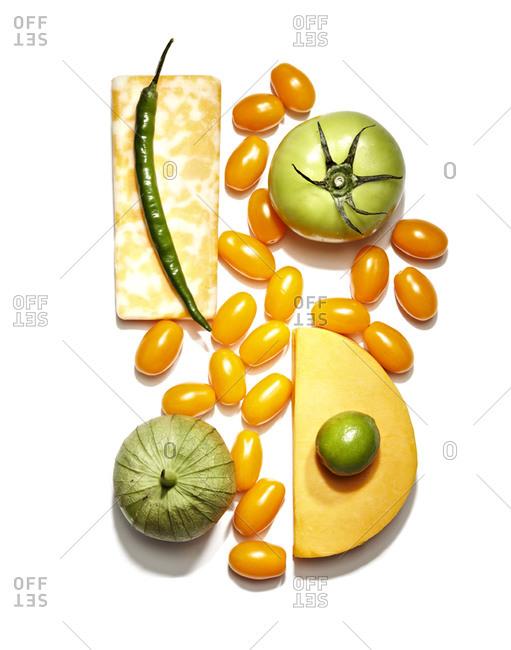 Various cheese and veggies, white background