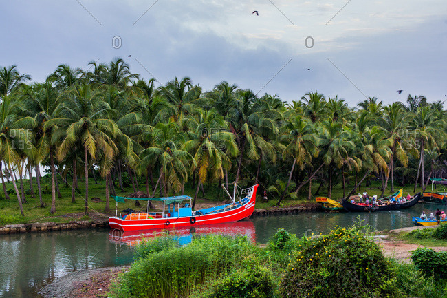 Kerala, India - September 11, 2013: Boats at the coast of Kozhikode, India