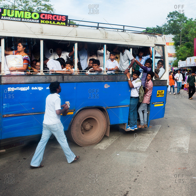 Kerala, India - September 10, 2013: People traveling by a crowded local bus in Kollam, India