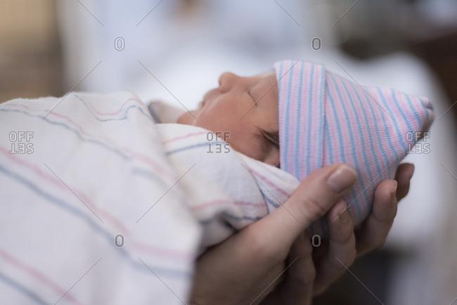 Newborn baby boy being held