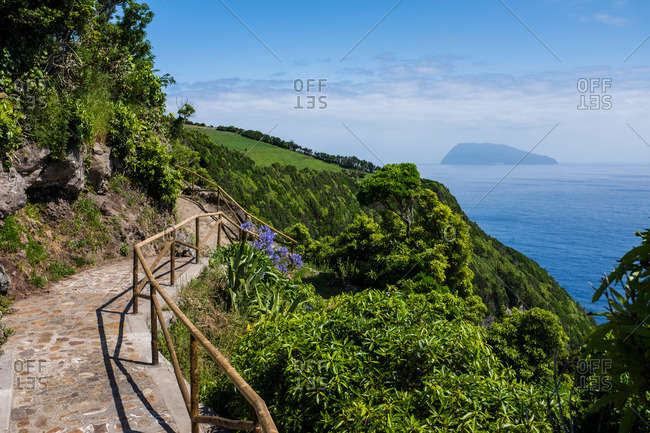 Mountain path overlooking the coast of Flores Island, Portugal