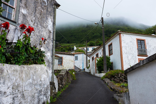 Uphill road through the village of Fajazinha, Portugal