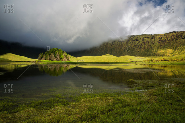 Reflections in a lagoon in Corvo cauldron, Azores, Portugal