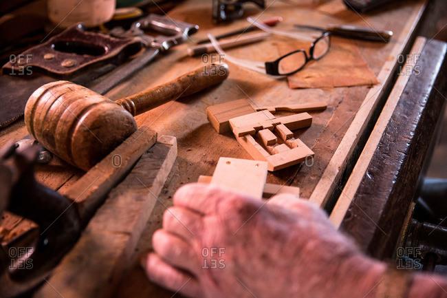 Hands of a man making a traditional door lock, Corvo Island, Portugal
