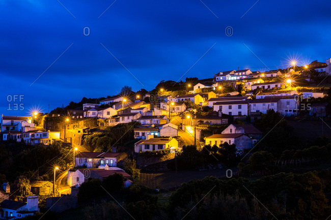Faja do Conde hillside village illuminated at dusk, Flores Island, Portugal