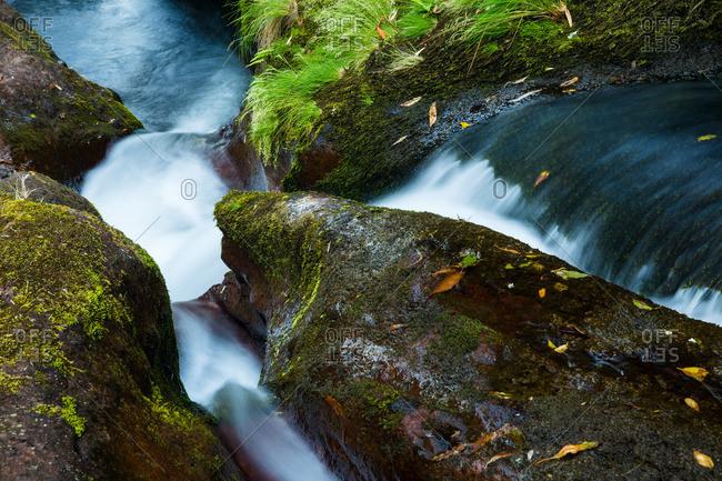 Ribeira da Alagoa small waterfall cascading over rocks on Flores Island, Portugal