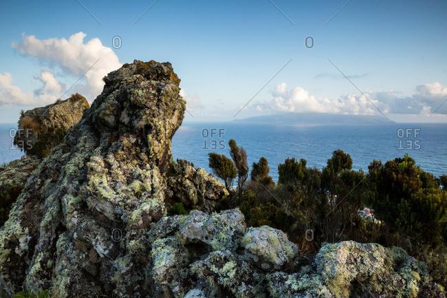 Mossy rocks on a seaside cliff, Corvo Island, Portugal