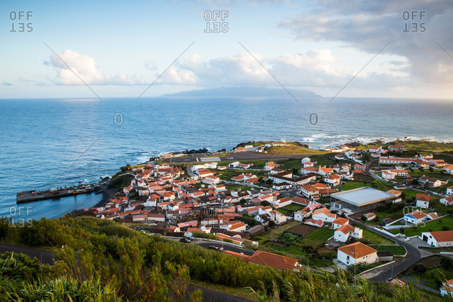 Corvo seaside village with a view of Flores Island in the distance, Portugal