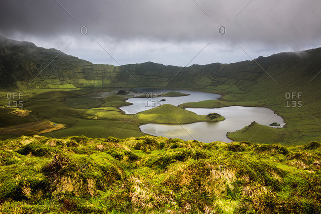 Lakes and patchwork pastures in the crater at Corvo Cauldron, Portugal