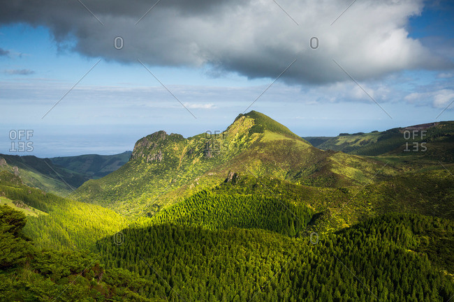 Pico do Se mountain peak rising above green forests on Flores Island, Portugal
