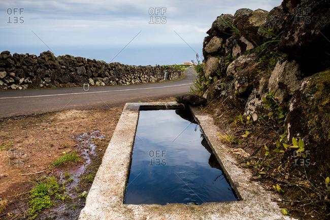Roadside drinking fountain on Corvo Island, Portugal