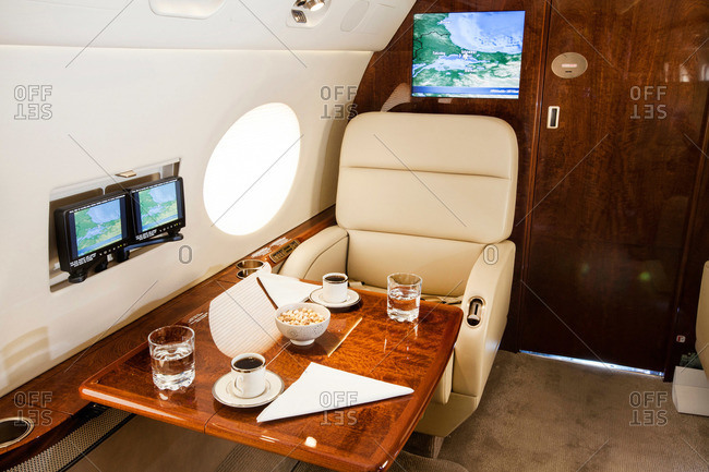 Table with coffee and snacks in a private jetliner