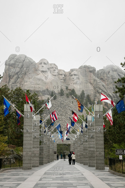 Entrance to Mount Rushmore with international flags