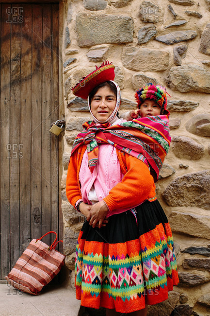 Peru - September 2, 2015: Quechua mother and child in a small Andean town