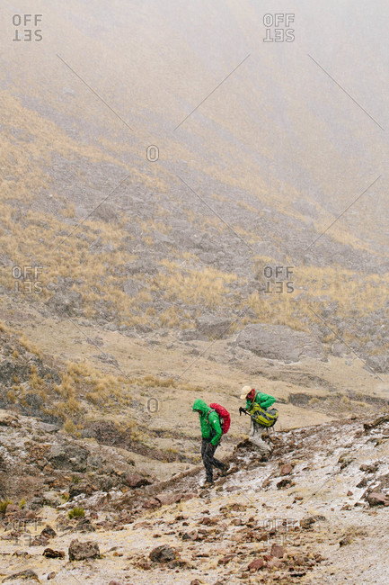 Hikers in the snow at Ausangate in the Andes Mountains of Peru