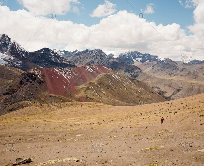 Lone hiker at Ausangate in the Andes Mountains of Peru
