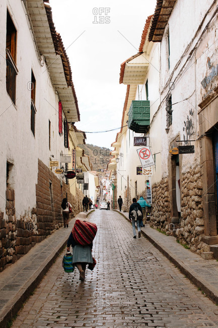 Cusco, Peru - September 3, 32015: Pedestrians on narrow street