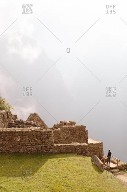 Tourist visiting Machu Picchu, Peru