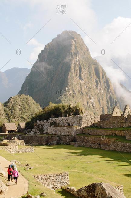 Tourists at Machu Picchu historic site in Peru