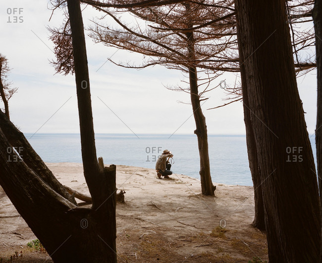 Man photographing on the coast of California
