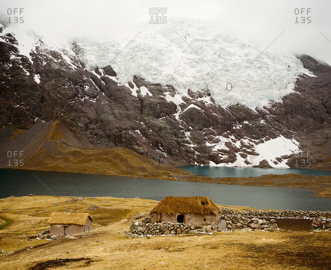 Earthen hut and glacier at Ausangate in the Andes Mountains of Peru