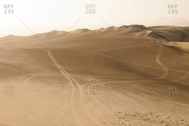 Vehicle tracks on sand dunes in Peru