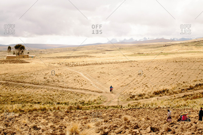 Tinki, Peru - September 4, 2015: Man riding a dirt bike