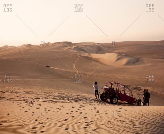 Tourists and dune buggies at Paracas Reserve in Inca, Peru