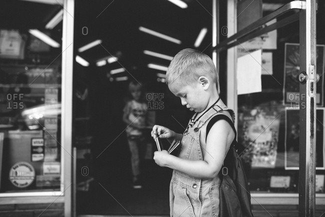 Boy standing outside of a store