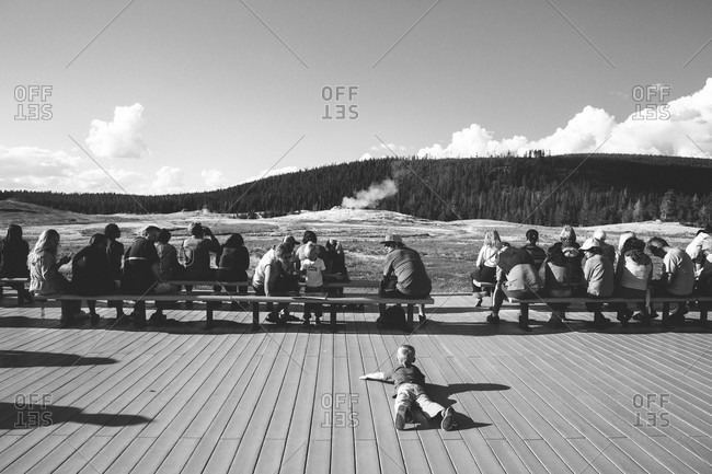 Yellowstone National Park, Wyoming - June 11, 2015: Tourists at Old Faithful geyser