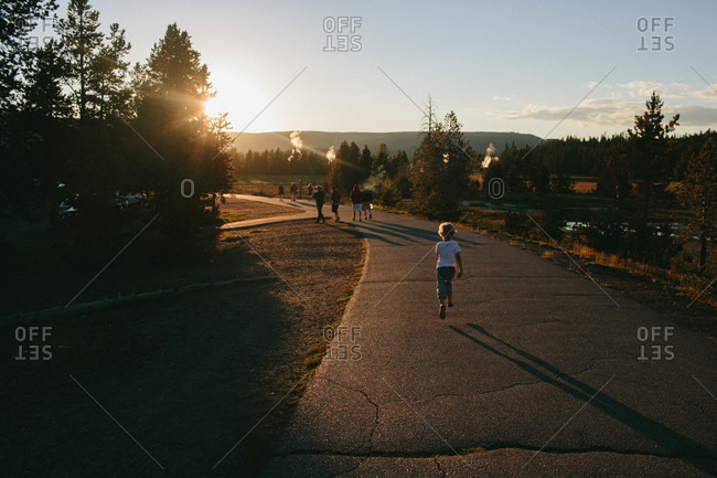 Boy running on a path at Yellowstone National Park in Wyoming