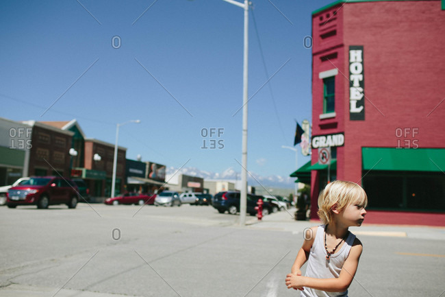 Boy on a street corner in a small town