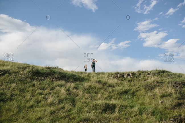Mother and son standing at the top of a hill