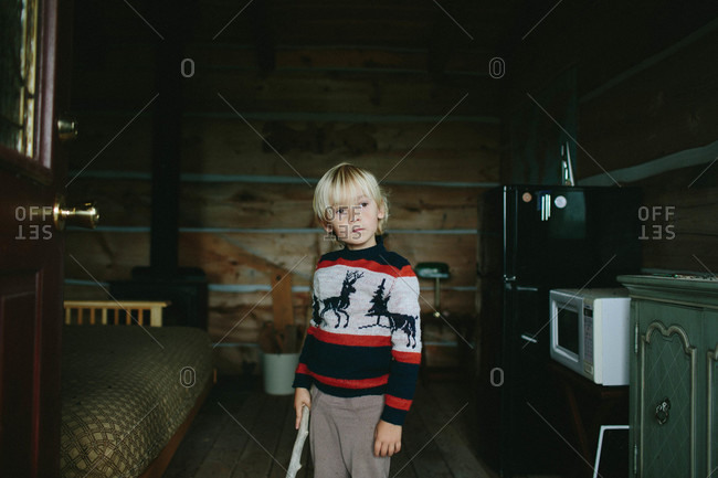 Boy standing inside a small cabin