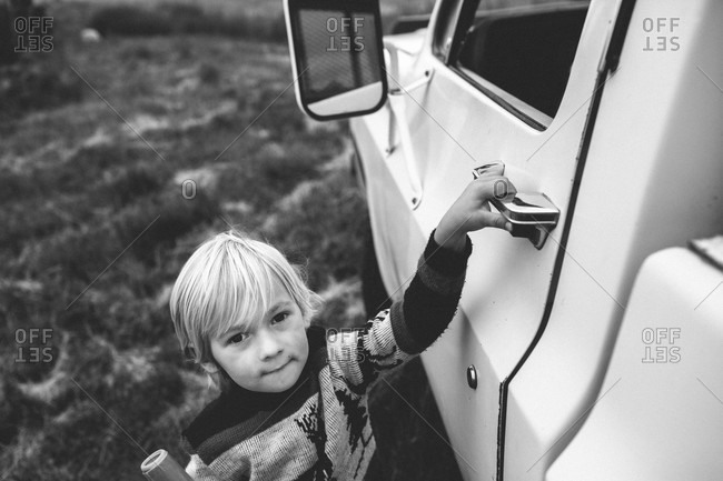 Boy opening door to a pick-up truck