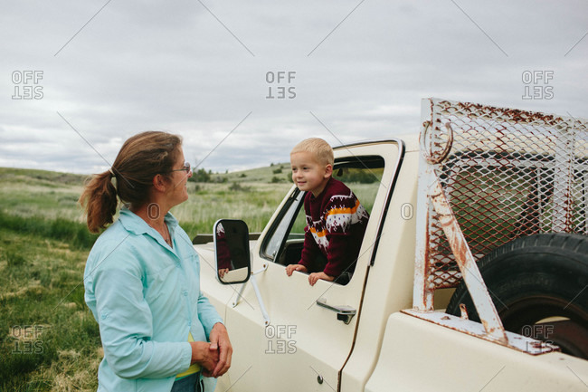 Boy playing in a truck with his grandmother